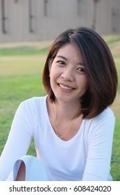 Asian woman smiling happy portrait. Beautiful mature middle aged Asian woman close up beauty portrait.