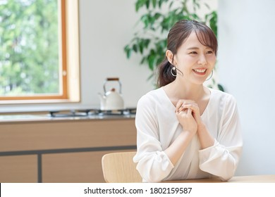 Asian woman smiling at home