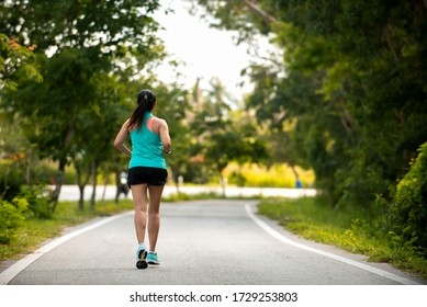 Asian woman  in sport wear jogging  on raod at park , Healthy sport lifestyle Concept