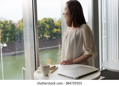 asian woman standing near the table