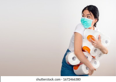 An Asian woman storing tissue toilet paper during Coronavirus outbreak or Covid-19, Concept of Covid-19 quarantine. Wuhan epidemic outbreak. Dangerous COVID virus, Doomsday panic people panic