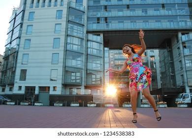 Asian woman in summer dress at street