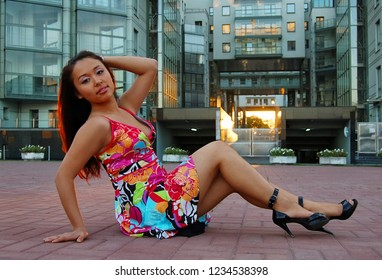 Asian woman in summer dress at street