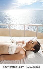 Asian woman sunbathing in Boracay in Philippines