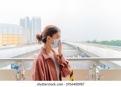 Asian woman with surgical mask face protection, Worried, scare, panicked, paranoid of pandemic, young girl in the skytrain background, Social distancing lifestyle, covid-19, medical, bangkok, thailand