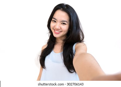 An asian woman taking self portrait isolated on white