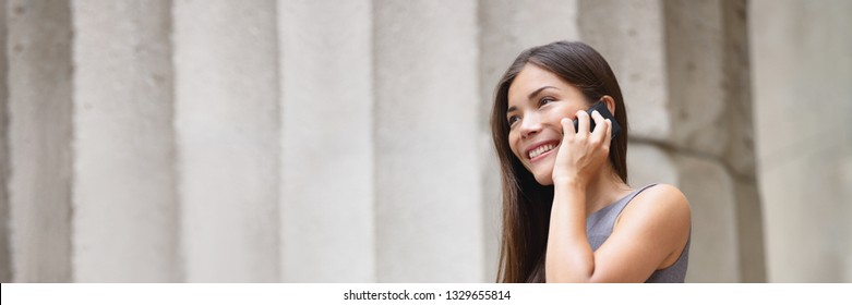 Asian woman talking on the phone calling as real estate agent broker professional working outside banner panorama. Businesswoman background.