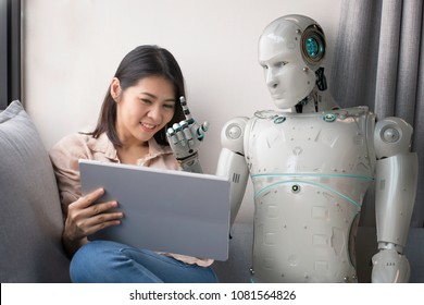 asian woman talking to robot while using digital tablet at home