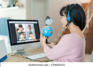 Asian woman teacher teaching geography via video conference e-learning and cheerful elementary school student looking at globe, Homeschooling and distance learning ,online ,education and internet.