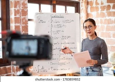 Asian woman teacher teaching online lesson via internet at home, self study and e-learning new normal concept