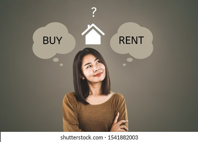 Asian woman thinking buy or rent home concept with question mark in background