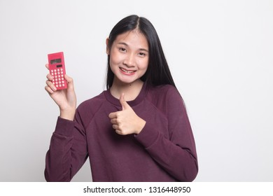 Asian woman thumbs up with calculator on white background