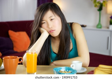 Asian woman tired waking up early for work
