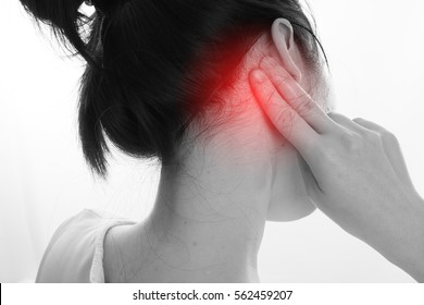 Asian Woman touch behind the ears for check Pulse on isolated white background, concept of health care lifestyle. focus from top view.