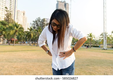 Asian woman touching her own belly with stomachache, appendicitis pain