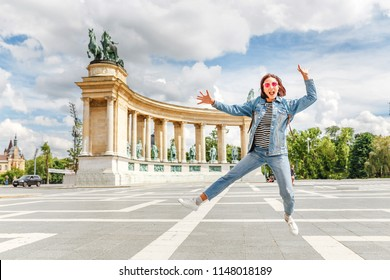 An Asian woman tourist on one of the main attractions of Budapest - Heroes Square. Concept travel throughout Europe and Hungary