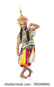 Asian woman in traditional costume of Southern Thailand. Nora dance show. Two leg down, left hand down and right hand raise.
