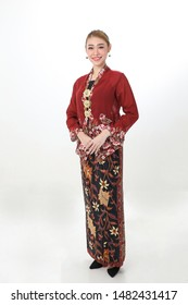 Asian woman traditional red maroon kebaya sharong on white background happy smile