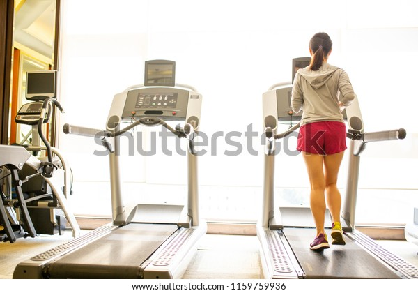 Asian woman training activity sport in Fitness room.