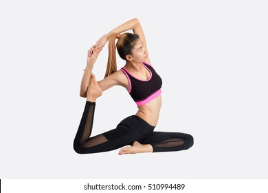 Asian woman training in yoga asana - pigeon pose  isolated on white background