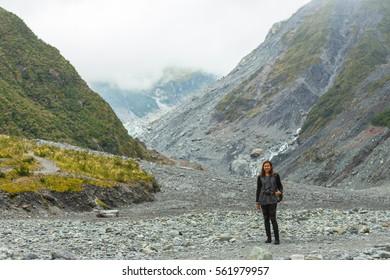 Asian woman travel enjoy at fox glacier in New Zealand