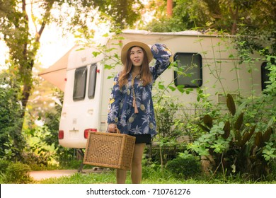 Asian woman is travel into jungle with sleeping van camp.