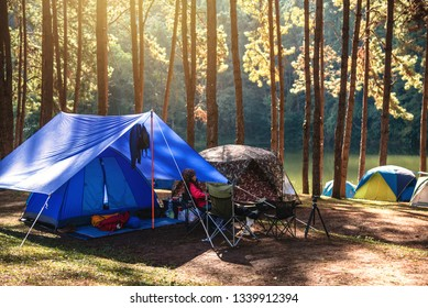 Asian woman travel nature camping on the Mountain see the lake in the mist at morning sunrise at Pang Ung , Mae Hong Son province, Thailand.