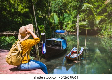 Asian woman travel nature. Travel relax.a boat photo. Sitting watching the beautiful nature at tha pom-klong-song-nam. Krabi, in Thailand.