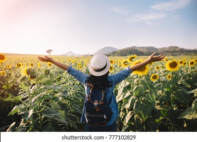 asian woman traveler hand up relax with backpack looking at amazing mountains and forest,  travel holiday relaxation concept,