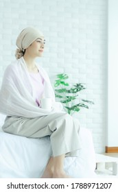 Asian woman turbaning her head. The girl is sick with a bad disease.Do not focus on the object.
