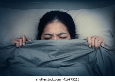 Asian woman unable to fall as sleep. Asian girl having trouble with getting up early in the morning, Nightmare.