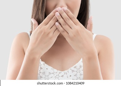 Asian woman use both hands close mouth for not commenting or refusing on gray background