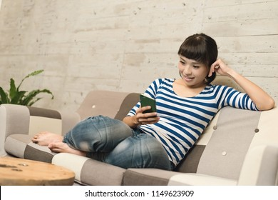 Asian woman use a cellphone at home