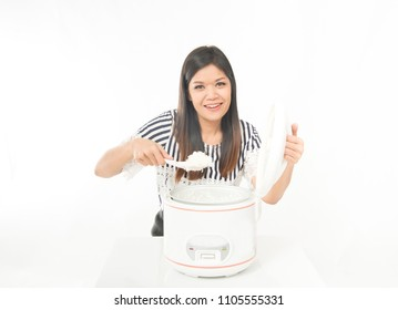 Asian woman use a rice cooker cook for meal in the kitchen