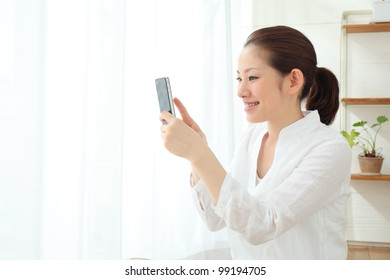 asian woman using cellphone