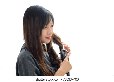 Asian Woman using Curling Iron Curling hair. Hairstyle And Hairdressing isolate on white background.