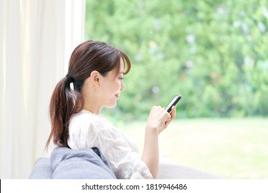 Asian woman using the smart phone