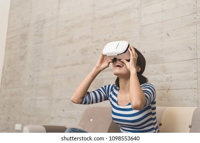 Asian woman using vr headset at home