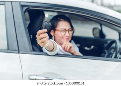 Asian woman is very happy. After she got the car. Focus on the keys.