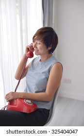 Asian woman with vintage telephone