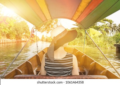 asian woman visiting the Floating Market in Bangkok on a boat tour