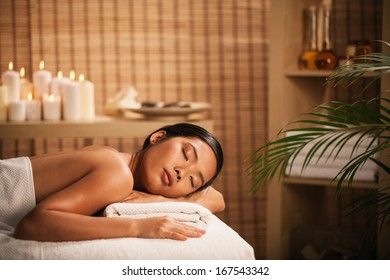 Asian woman waiting for a massage at a spa centre.