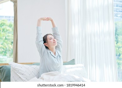 Asian woman waking up at home