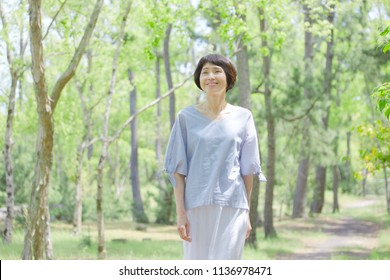 Asian woman walking in the nature