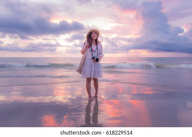 Asian woman is walking on the beach in Phuket, Thailand.