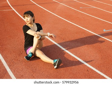 Asian woman warm up at running track
