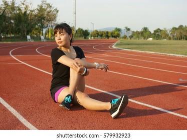 Asian woman warmup at running track