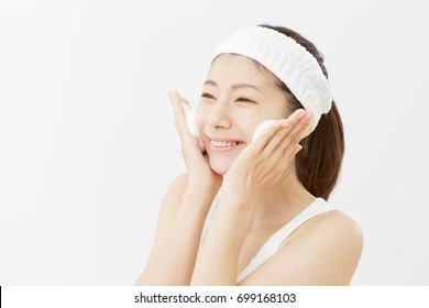 Asian woman washing a face