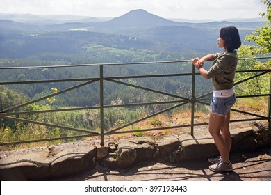 Asian woman watching view of the valley, Czech republic