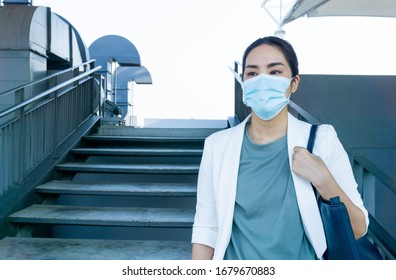 Asian woman wear mask and going to work with worried face